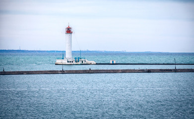 Vorontsovsky lighthouse near a pier in Odessa port, Ukraine