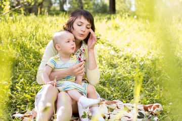 mom and kid outdoors at summer