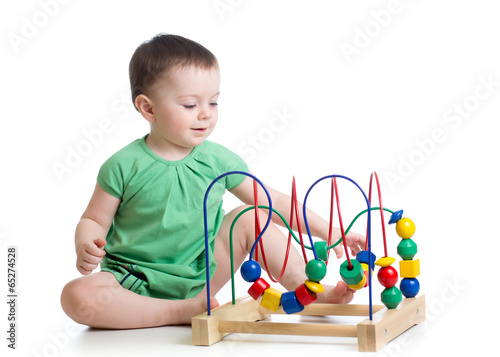 kid girl playing with educational toy