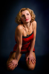 blond woman in a red dress