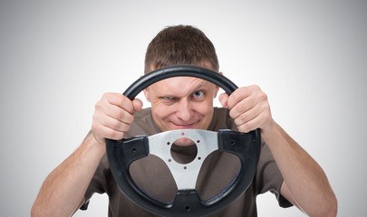 Man with a steering wheel, driver auto concept
