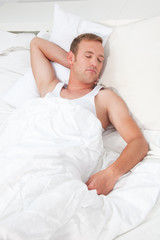 Man Comfortably Sleeping on Bed