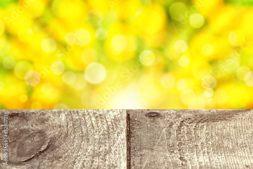 Empty rustic wooden table with abstract spring background
