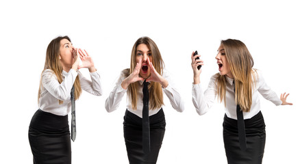 Young businesswoman shouting over isolated white background
