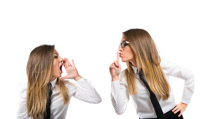 Young businesswoman making silence gesture over isolated white b