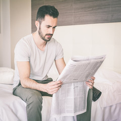 Man Reading Newspaper on Vacation