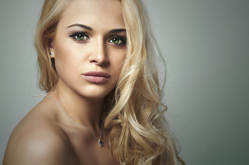 Beautiful funny woman.Flirt Blond Girl with Curly hair.Enjoy