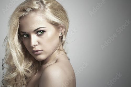 Fashion portrait of young beautiful woman.Sexy Blond girl