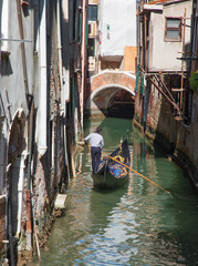 Venice  - Gondolier on the little canal in center of the town.