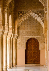 Alhambra marble hallway leading to a wood door