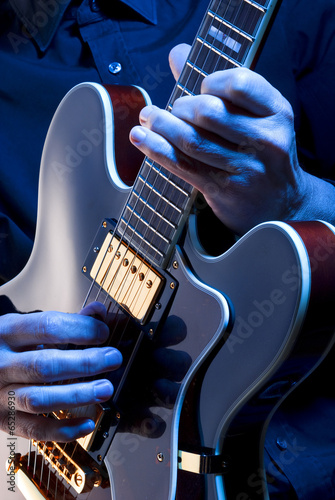 playing blues guitar - 65286930