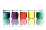 jars of colored water stacked on white background