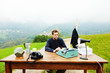 boy working in his office on a hill
