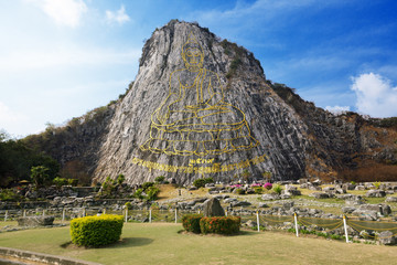 Carved golden buddha image on cliff at Khao Chee Jan, Thailand