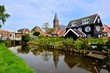 Dutch fishing village of Marken with canal and reflections