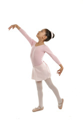 young cute ballet dancer girl dancing classical in pink tutu