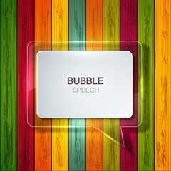 Vector bubble speech icon on wooden background.