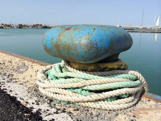 blue bollard with a rope