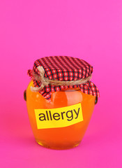 Honey allergy on pink background