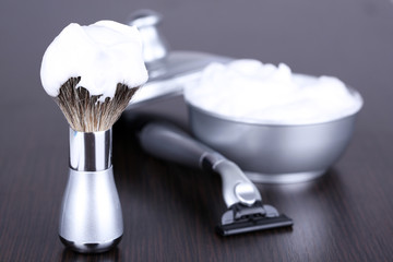 Male luxury shaving kit on wooden background
