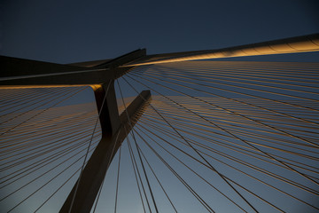 Beautiful photo of a rope bridge at sunset