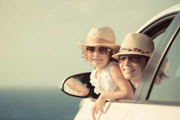 Happy woman and child in car