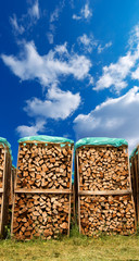 Pile of Chopped Firewood on Blue Sky