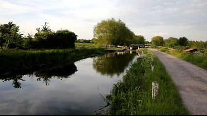 English country scene with canal and lock gates