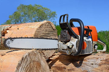 Chain saw on logs