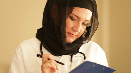 Portrait of a female muslim doctor smiling to a camera