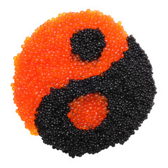 Black and red caviar forming a yin yang symbol
