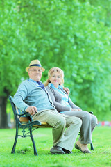 Mature man and woman relaxing in park
