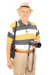 Mature photographer holding camera and