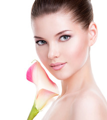 Beautiful face of young pretty woman with healthy skin.