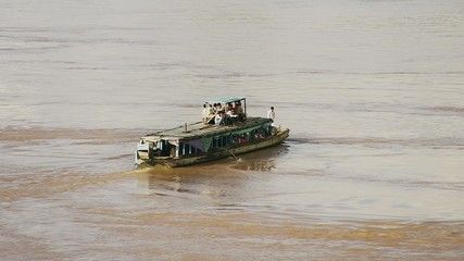 People in local ferry crossing Mekong, Kampong Cham , Cambodia