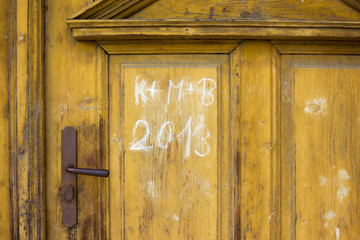 Vintage door with handle and chalky inscription of Three Kings