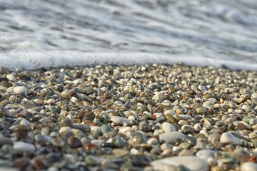 Small pebbles and waves