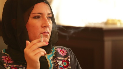 muslim woman smoking