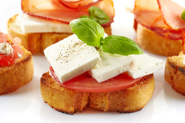 Toasted bread with fresh goat cheese and tomato