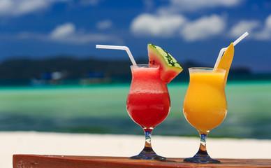 fruit cocktails on tropical beach