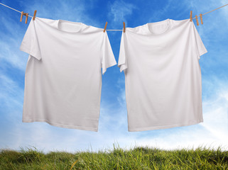 Blank white t-shirt hanging on clothesline