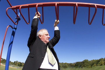 Businessman on Jungle Gym