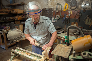 The man works in the home joinery.