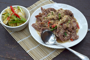 Beef Bulgogi - Korean marinated BBQ beef served with kimchi, ssa