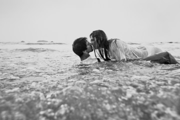 sex on the beach, young couple kissing