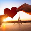 Leinwanddruck Bild - heart in hands, loving couple in Paris, France