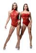 Athletic girls posing over white background