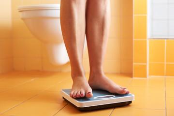 A pair of female feet on a bathroom scale