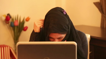 Muslim woman video chatting