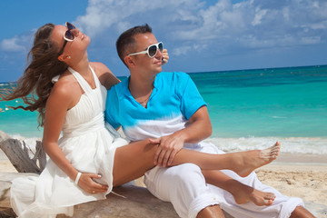 Young outdoor fashion portrait of beautiful couple on vacation
